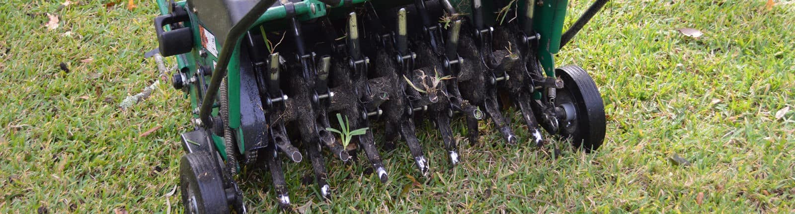 Aeration machine sitting on lawn